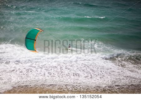 Kite surfing on a sunny day, kite surfer in action