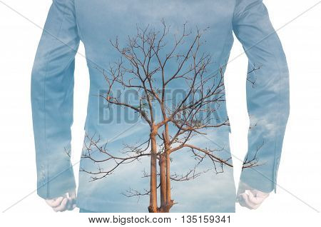 Double Exposure Of Businessman And Dead Tree