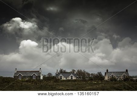 Residential homes on Guernsey island, UK, with dramatic sky