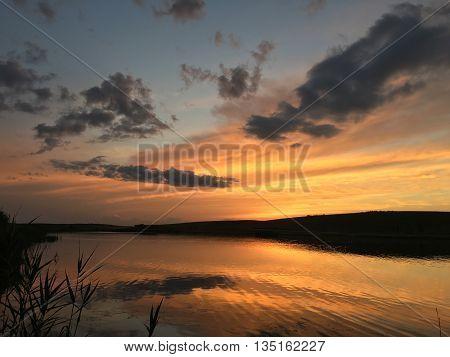 Lake sunset blue sky landscape in ukraine
