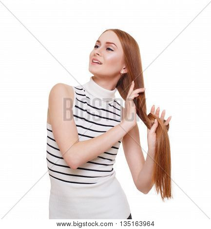 Redhead woman with strong healthy hair portrait. Young red ginger girl shows natural hair strength. Beautiful, stylish, attractive girl isolated at white background. Hair care, hairstyle.