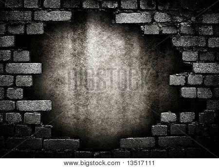 Ziegelmauer mit grossem Loch