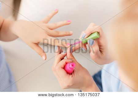Ready to summer. Close up of mother with daughters with colorful fingernails enjoying summer