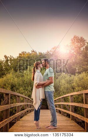 happy lovely couple on sunset bridge