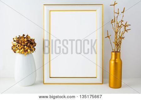 Frame mockup with white and golden vases. Portrait or poster white frame mockup. Empty white frame mockup for design presentation.