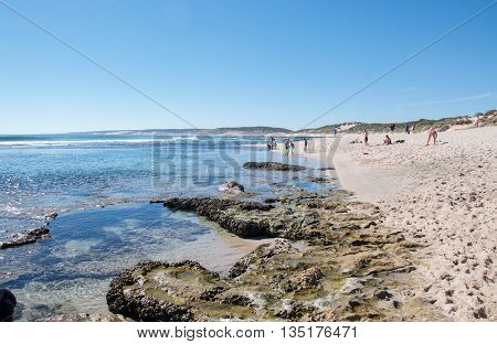 KALBARRI,WA,AUSTRALIA-APRIL 21,2016: Tourists at the Blue Holes beach with fringe reef, rock pools and Indian Ocean waters on the coral coast of Kalbarri, Western Australia.