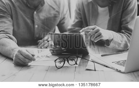 Coworkers team brainstorming process modern loft.Young business crew working startup studio.Using Laptop.Blurred, film effect. Black White