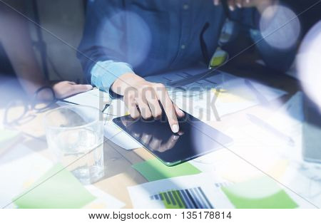 Woman Touch Screen Digital Tablet Hand.Project Managers Researching Process.Business Team Working Startup modern Office.Analyze market stock.Using electronic devices, papers, notes wood table.Blurred