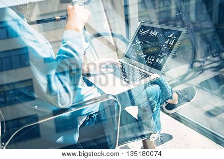 Work process modern Studio Loft.Creative director working coworkers office new freelance business startup.Using Laptop graph chart screen.Horizontal.Film effect, reflections window.Blurred background