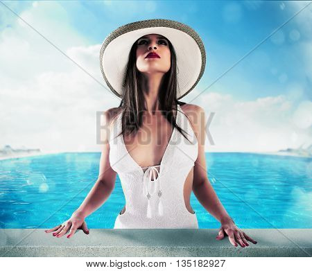 Woman with elegant hat out of the pool