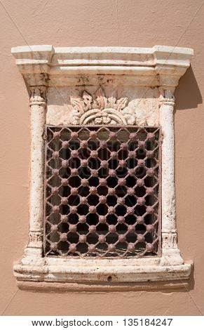 Window of an old building in Hersonissos Crete Greece.