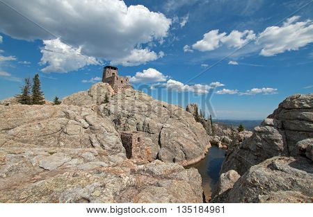 Harney Peak Fire Lookout Tower in Custer State Park in the Black Hills of South Dakota USA with snowmelt water below it
