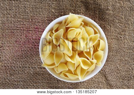 top view of pasta on top of sack cloth