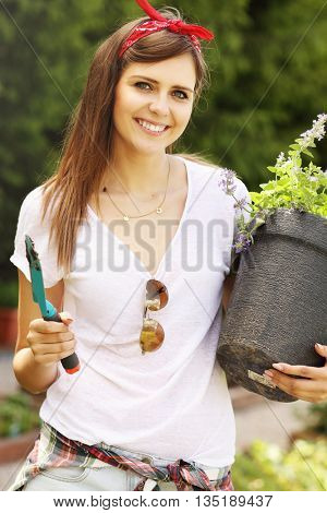 Picture of a young woman working in her garden