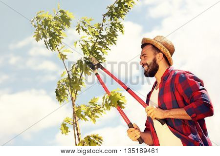 Picture of a young man working in his garden