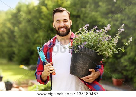 Picture of a young farmer working in his garden