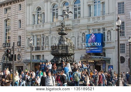 LONDON, UK - OCTOBER 4, 2015: Eros monument at Piccadilly circus and lots of people crossing the road