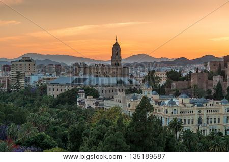 Cityscape and Cathedral at sunset in Malaga Spain.