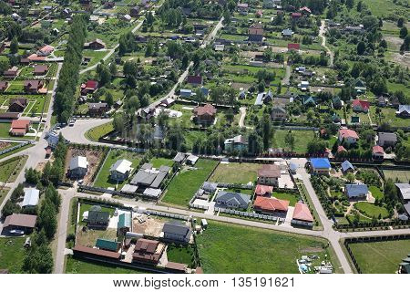 Aerial Views - Russian village intersection. Shooting from the helicopter.