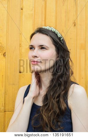 girl with flowers branches spirea on head