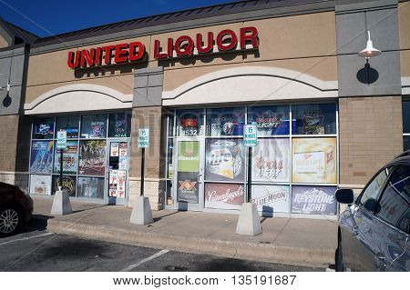 JOLIET, ILLINOIS / UNITED STATES - JUNE 1, 2015: One may purchase liquor at the United Liquor store in a Joliet strip mall.