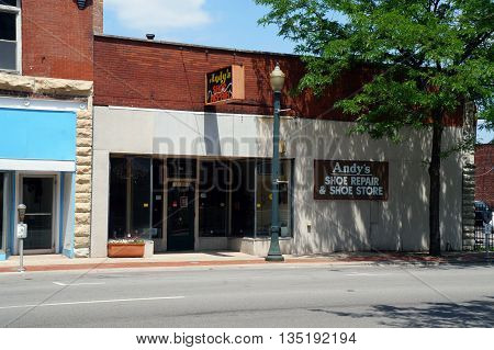 JOLIET, ILLINOIS / UNITED STATES - JUNE 3, 2015: One may buy shoes, or have one's shoes repaired, at Andy's Shoe Repair & Shoe Store, in downtown Joliet.