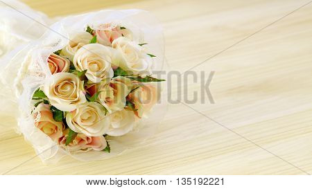Satin Rose Bouquet On Pine Wood Background.