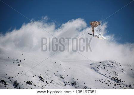 Ski rider jumping on mountains. Extreme ski freeride sport.