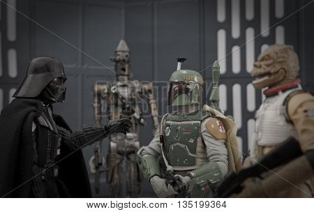 BLOOMFIELD NJ - JUNE12 2016: Recreation of a scene from Star Wars The Empire Strikes Back where Darth Vader instructs bounty hunter Boba Fett that he wants Han Solo alive with No Disintegrations.