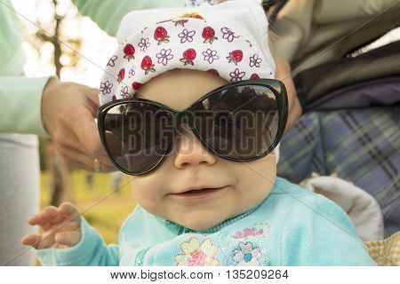 Small Baby Outdoor In A Summer Day