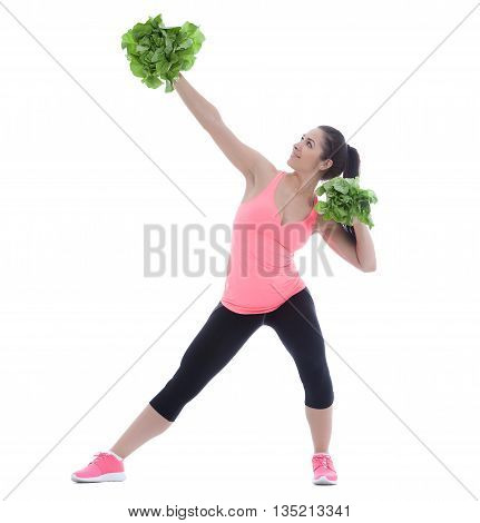 Funny studio shot of a woman holding two salads and acting as a cheerleader.