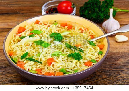 Tasty Chicken Soup with Chinese Noodles. Studio Photo