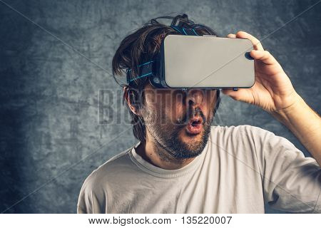 Man watching 3d pornographic content using virtual reality goggles