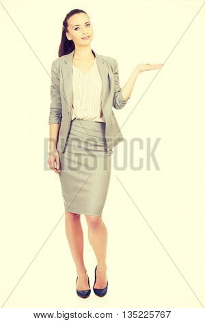 Businesswoman showing empty hand.
