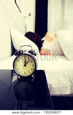 Woman sleeping in bed.