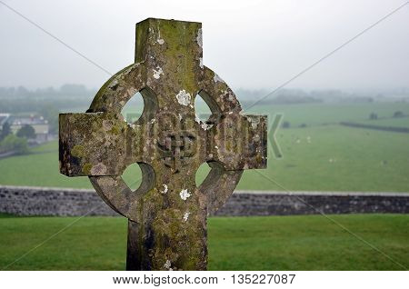 Celtic Cross On The Graveyard And Nature Landscape
