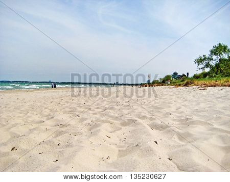 Beach in Timmendorfer Strand Schleswig-Holstein - wide sandy beach without beach chairs at baltic sea - view towards pier