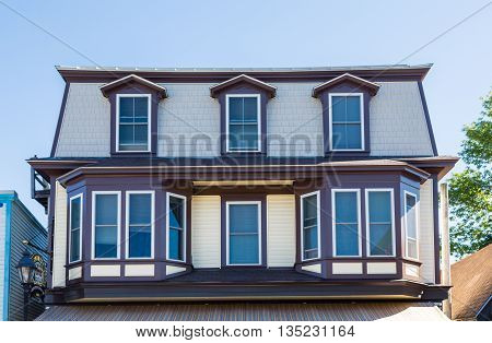Bay Windows and Dormers on wood building