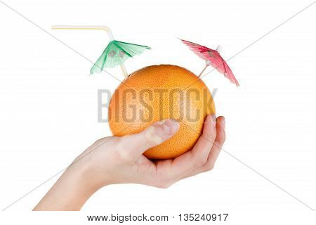 Concept Diet and healthy eating. Grapefruit with drinking straw and umbrella in hand isolated on white