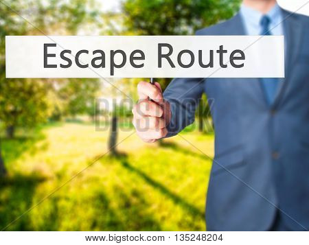 Escape Route - Businessman Hand Holding Sign