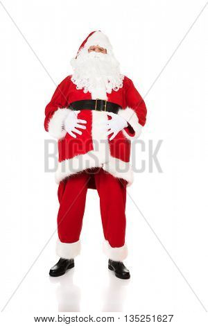 Happy Santa Claus holding his fat belly