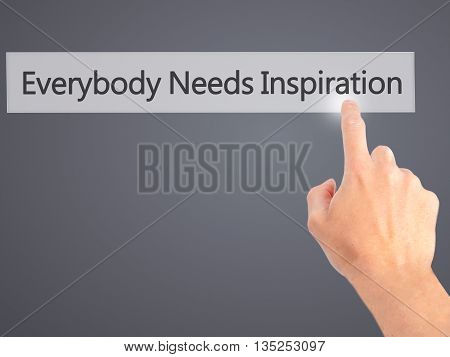 Everybody Needs Inspiration - Hand Pressing A Button On Blurred Background Concept On Visual Screen.