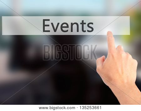 Events - Hand Pressing A Button On Blurred Background Concept On Visual Screen.
