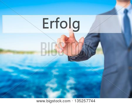 Erfolg (success) - Businessman Hand Pressing Button On Touch Screen Interface.
