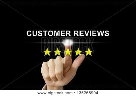 business hand clicking customer reviews with five stars on screen
