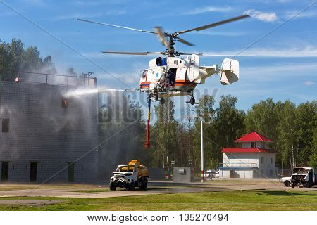 RUSSIA NOGINSK - AUGUST 7, 2015: The helicopter MI-8 in the sky on doctrines of rescuers of Ministry of Emergency Situations of Russia.