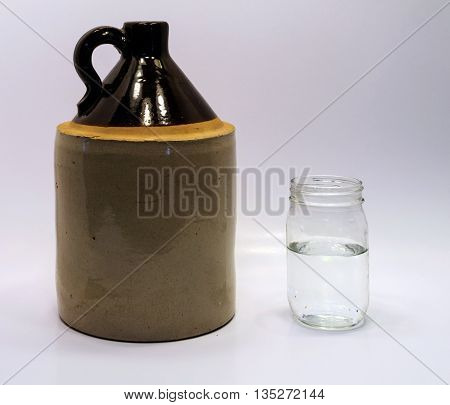 Moonshine Jug And Jar On A White Background