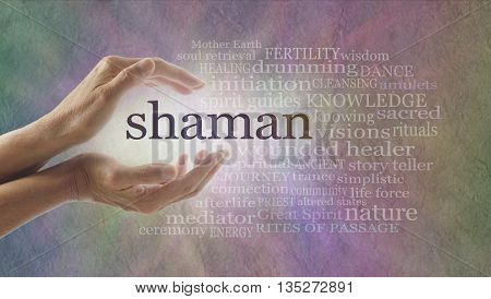 Shaman word cloud and healing hands - female cupped hands with the word SHAMAN between lit by white light surrounded by a word cloud on a pastel colored stone effect background