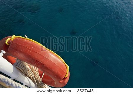 Orange life preserver on a background of blue sea