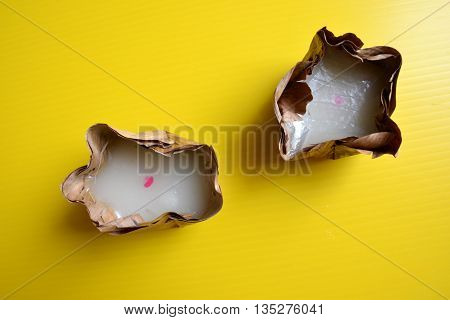 Two Nian gao on yellow background - food for Chinese Moon Festival